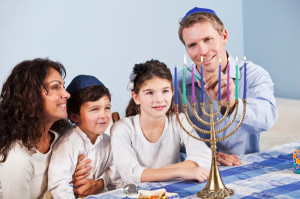 jewish-family-celebrating-hanukkah-menorrah